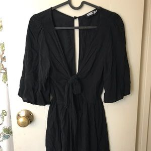 Adorable Black front tie romper